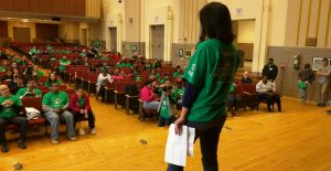 Comcast Cares Day coordinator Kristina Chang (254) instructs volunteers in Central's auditorium Saturday April 30 as they prepared to tackle beautification projects around the school.
